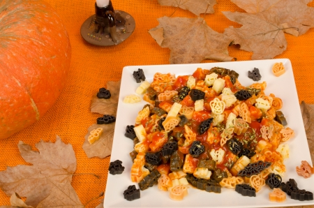 party with food: Halloween related designs in a plate of pasta, kid Halloween party food