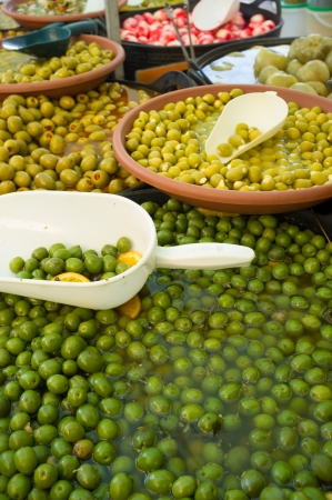 andalusian cuisine: Assorted pickled and stuffed olives on a market stall