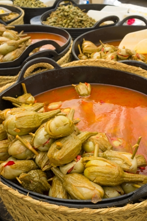 market stall: Market stall displaying an assortment of pickled aubergines Stock Photo