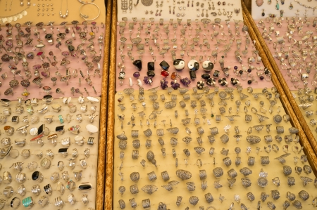 market stall: Silver trinkets displayed on a market stall Stock Photo