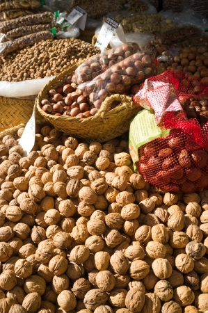street market: Heaps of nuts on a traditional street market stall Stock Photo