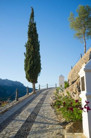 viacrucis: Traditioanal uphill via crucis under Mediterranean sunlight