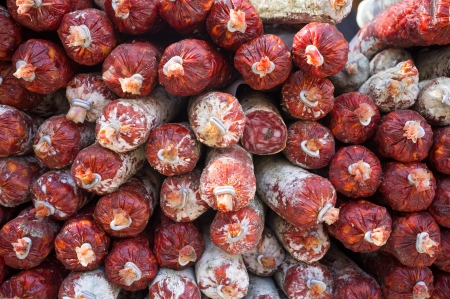 chorizos: Stack of chorizos, traditional Spanish sausages on a market stall Stock Photo