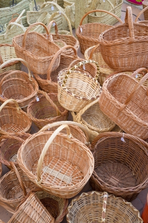 Full frame take of a heap of wickerwork baskets at a traditional street market stall