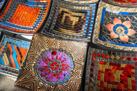 handcrafted: Traditional handcrafted enamel plates on display on a street market