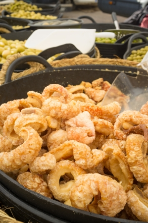 andalusian cuisine: Traditional chicharrones, fried pork rind, on display at a market stall Stock Photo