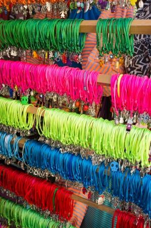 street market: Many colorful bracelets displayed on a street market stall