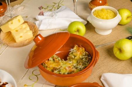kugel: Homemade kugel served on a festive Hanukkah table Stock Photo