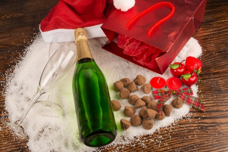 Bottle of champagne surrounded by a  Christmas still life