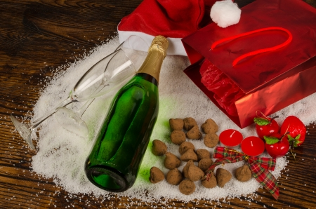 champagne truffles chocolate: Bottle of champagne surrounded by a  Christmas still life