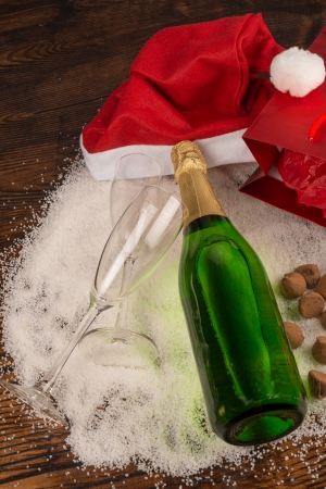 champagne truffles chocolate: Christmas party still life around a bottle of champagne Stock Photo