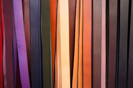 waistband: Colorful leather belts on a market stall