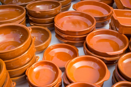handcrafted: Handcrafted earthenware pots and pans on display on a street market Stock Photo