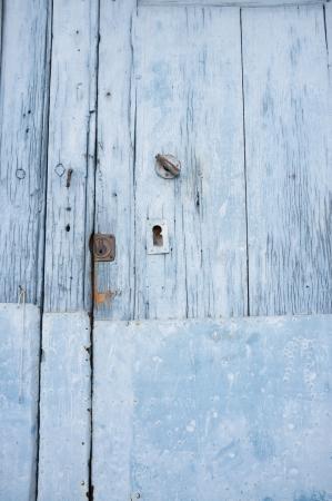 Old blue wooden door with rusty locks photo