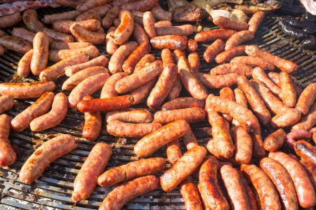 chorizos: Grilling a huge amount of spicy chorizos  Stock Photo
