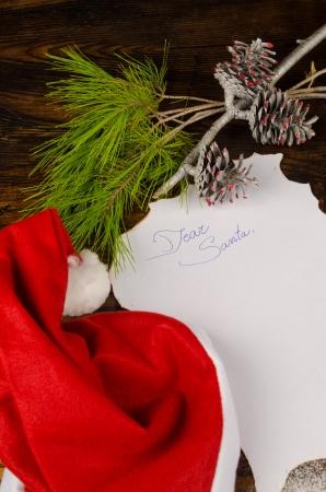 wish list: Christmas wish list surrounded by seasonal ornaments Stock Photo