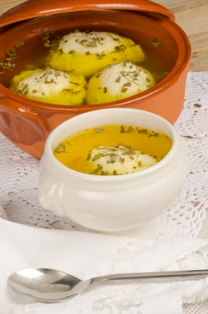 kneidl: Traditional homemade matza ball soup served in a bowl Stock Photo