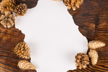 wish list: A Christmas wish list decorated with golden fir cones Stock Photo