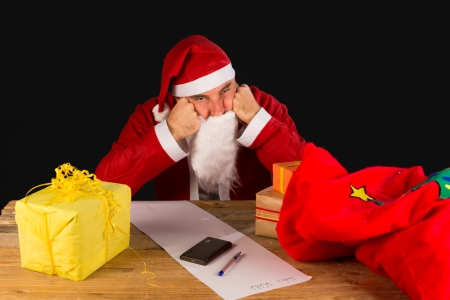 A sulky Santa completely fed up with the holiday season photo