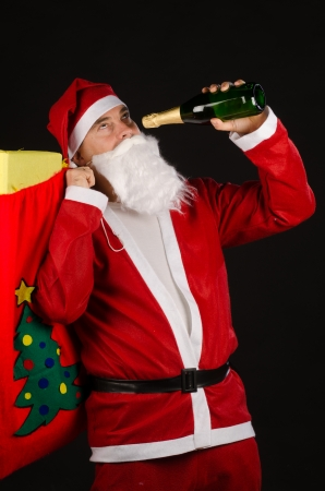 A frustrated Santa about to become an alcoholic photo