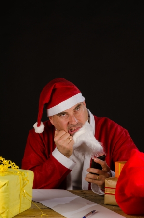 A frustrated Santa getting mad at the holiday season photo