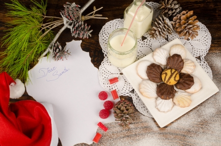 wish list: Treats for Santa and the wish list on a wooden table Stock Photo