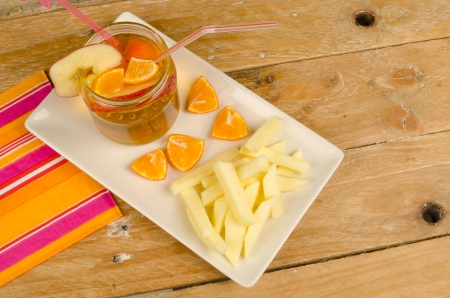 A kid dessert with apple slices resembling French fries photo