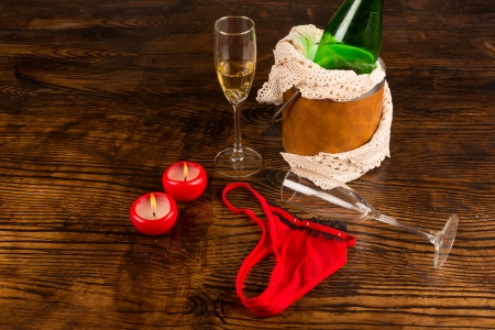 aftermath: Champagne, glasses and underwear scattered in a party aftermath