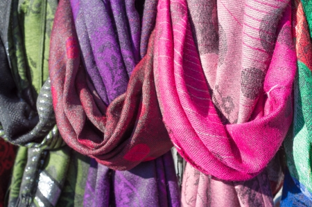 market stall: Colorful scarves  for sale on a street market stall Stock Photo