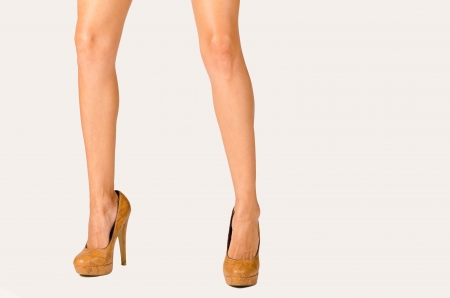 spread legs: Spread and firmly standing female legs in a studio shot