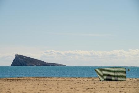 Benidorm beach and its landmark island with a lonely sunbather photo