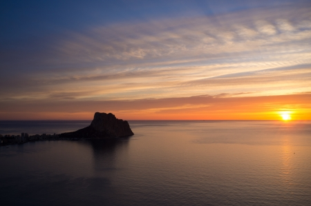 costa blanca: Sunrise ove the popular Calpe resort, Costa Blanca, Spain Stock Photo