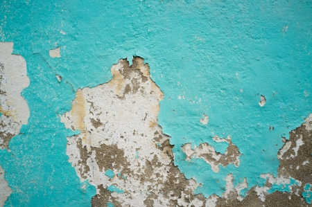 An old peeling wall in traditional Mediterranean blue photo