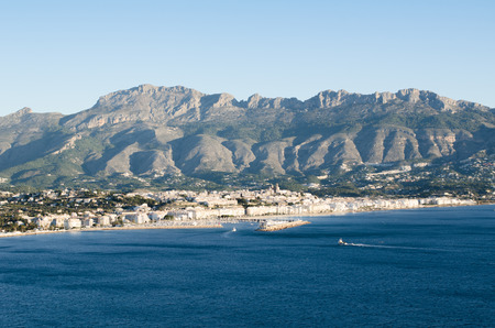 altea: The coastal town of Altea and its bay with fishing boats returning to harbor