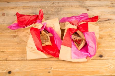 hamantashen: Traditional homemade hamestaschen in  a festive wrapping