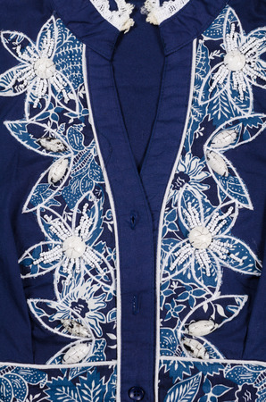 bead embroidery: Blue  fabric with a beaded white pattern Stock Photo