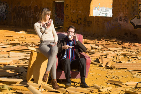 industrial ruins: Posh people having tea time among industrial ruins, a concept Stock Photo