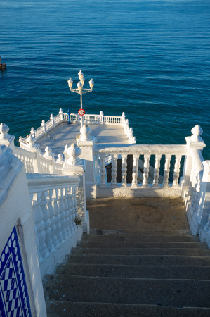 balustrades: Landmark Benidorm viewopoint,  whitawashed balustrades  against the background of the ocean Stock Photo