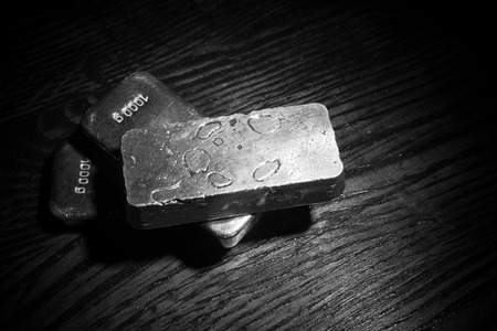 A low key stilll life with several  silver bars photo