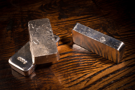 silver: Still life with silver bars on a wooden background Stock Photo