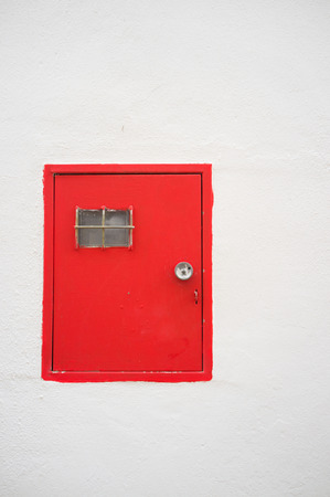 electricity meter: Red electricity meter door on a whitewashed Andalusian facade