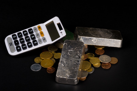 silver bars: Silver bars and coins, a financial concept