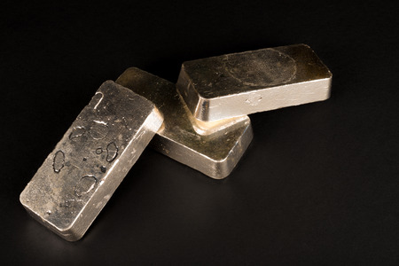 silver: Low key take of sterling silver bars on a black background