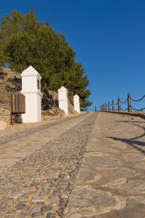 crucis: Steep street following a via crucis uphill