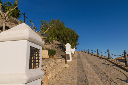 crucis: Uphill street with several via crucis stations Stock Photo