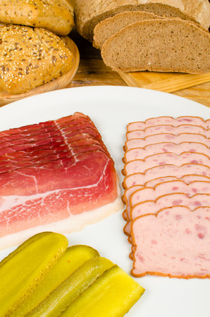 leberkaese: Cold meat with gherkins and assorted whole wheat bread
