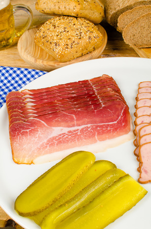 Cold meat with gherkins and assorted whole wheat bread