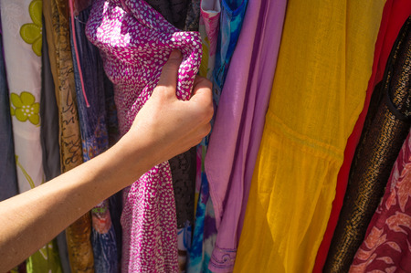 Choosing clothes in a market stall photo