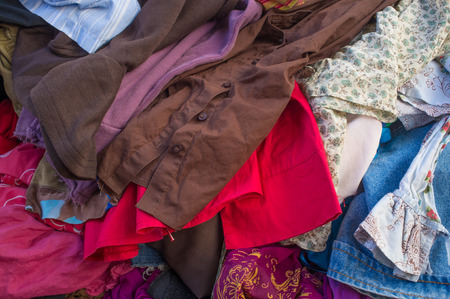 Pile of second hand clothes at a garage sales