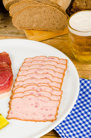 leberkaese: Cold meat, pickles, whole wheat bread and beer, a traditional German cold meal